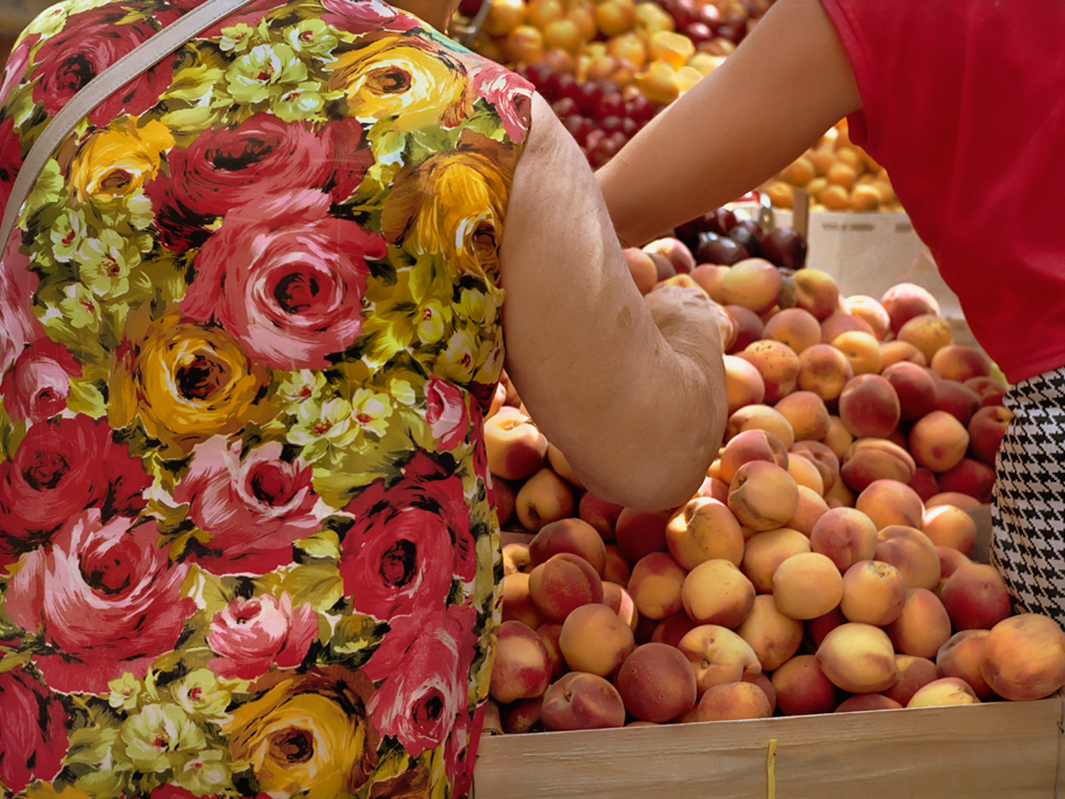 woman buying peaches