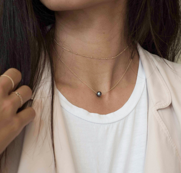 Mejuri black pearl necklace—a bunch of good necklaces for layering